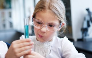 young girl holding test tube