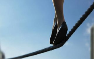 woman walking on tightrope